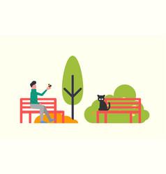Man sitting on bench black cat autumn trees vector