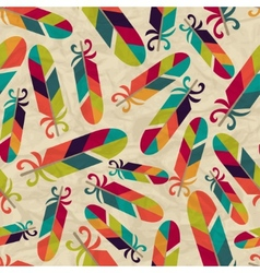 Seamless pattern with feathers on crumpled paper vector