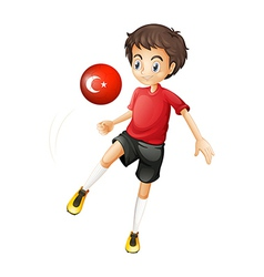 A boy using the ball with the flag of Turkey vector image