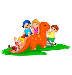 Happy children playing the dinosaur slide vector