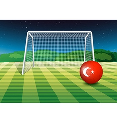 A ball at the soccer field with the flag of Turkey vector