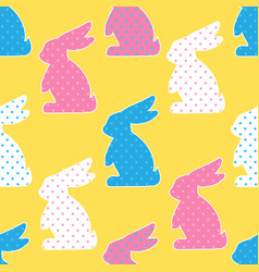 Seamless pattern with colorful rabbits on yellow vector