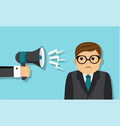 Businessman scolded into a megaphone vector