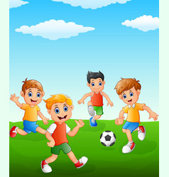 Happy kids playing soccer on the field vector