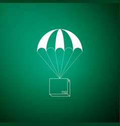 box flying on parachute icon on green background vector image