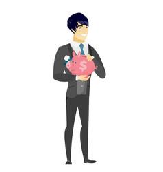 Asian groom holding a piggy bank vector