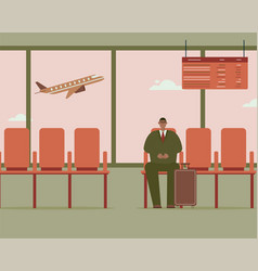 businessman with luggage is sitting in airport vector image
