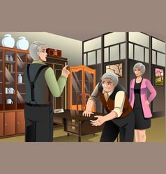 Mature couple buying antique furniture vector