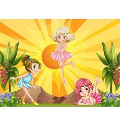 Three fairies flying in the garden vector image vector image