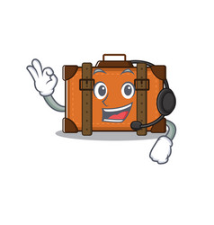 Suitcase with in cartoon with headphone shape vector