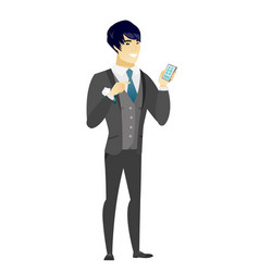 asian groom holding a mobile phone vector image