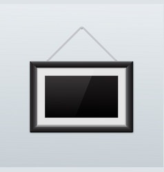 picture frame hanging on the wall black icon vector image vector image