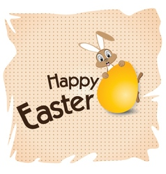 Easter bunny with Big gold egg on a white paper vector image