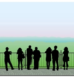 Silhouettes of people on the observation deck vector image