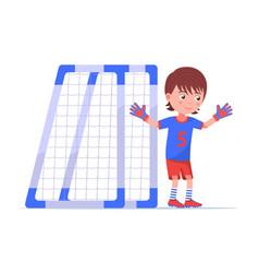 boy goalkeeper stands next to football goal vector image
