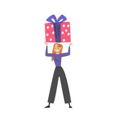 Joyful girl with huge gift box over her head vector