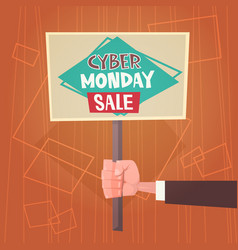 hand holding banner with text cyber monday sale vector image
