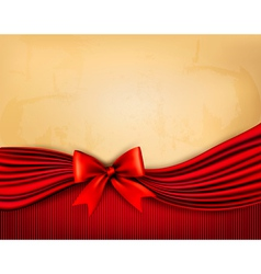 Holiday background with old paper and red gift bow vector