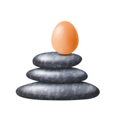 Zen spa stones stack with fragile egg on its top vector