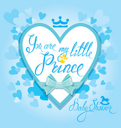 Baby shower with heart and crown on blue vector