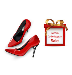 Red stiletto shoes with christmas gift box vector