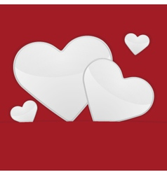 White hearts on a red background vector