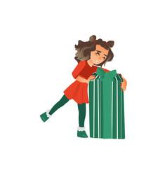 Happy teenage girl opening huge christmas present vector