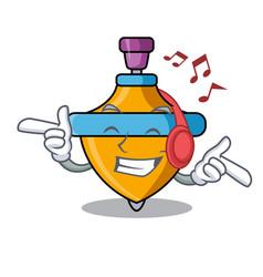 Listening music spinning top mascot cartoon vector