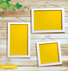 White photo frame on wood background vector image vector image