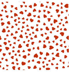 pattern of red hearts chaotically on white vector image