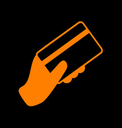 hand holding a credit card orange icon on black vector image