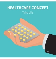 Man holding blister pack of pills in his hands vector image