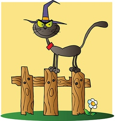 Halloween Witch Cat On A Fence Over Yellow vector image vector image