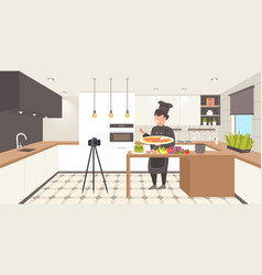 food blogger in uniform cooking pizza in kitchen vector image