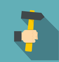 hand hoding hammer with yellow tool icon vector image