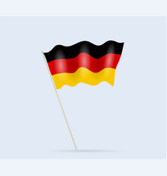 germany flag on flagpole waving in wind vector image
