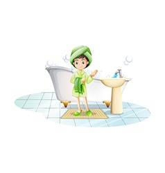 A young lady taking a bath with a green towel vector image