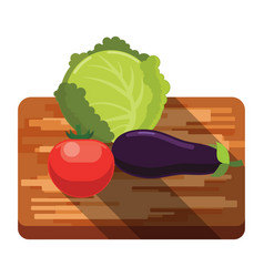 fresh cabbage tomato eggplant on a cutting board vector image