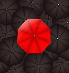 Red Umbrella Against Black Umbrellas vector