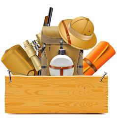 Wooden board with safari accessories vector