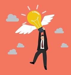 Businessman hold flying lightbulb vector image