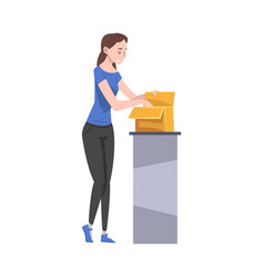 Girl standing at table packing cardboard box vector