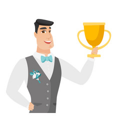Young caucasian groom holding a trophy vector