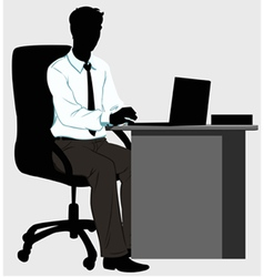 silhouette man at the Desk with laptop vector image vector image