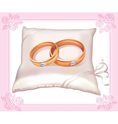 Wedding gold rings on satin pillow vector