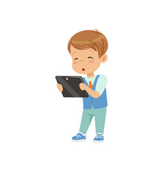 cute little boy standing with a tablet pc vector image