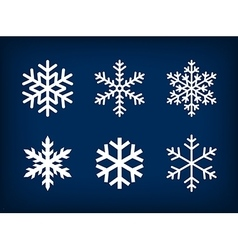 white snowflakes on dark blue background vector image