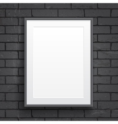 Blank paper poster with frame on brick wall vector