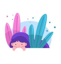 Cute adorable girl hiding peeking out grass vector