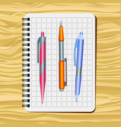 Notebook red pen orange pen vector